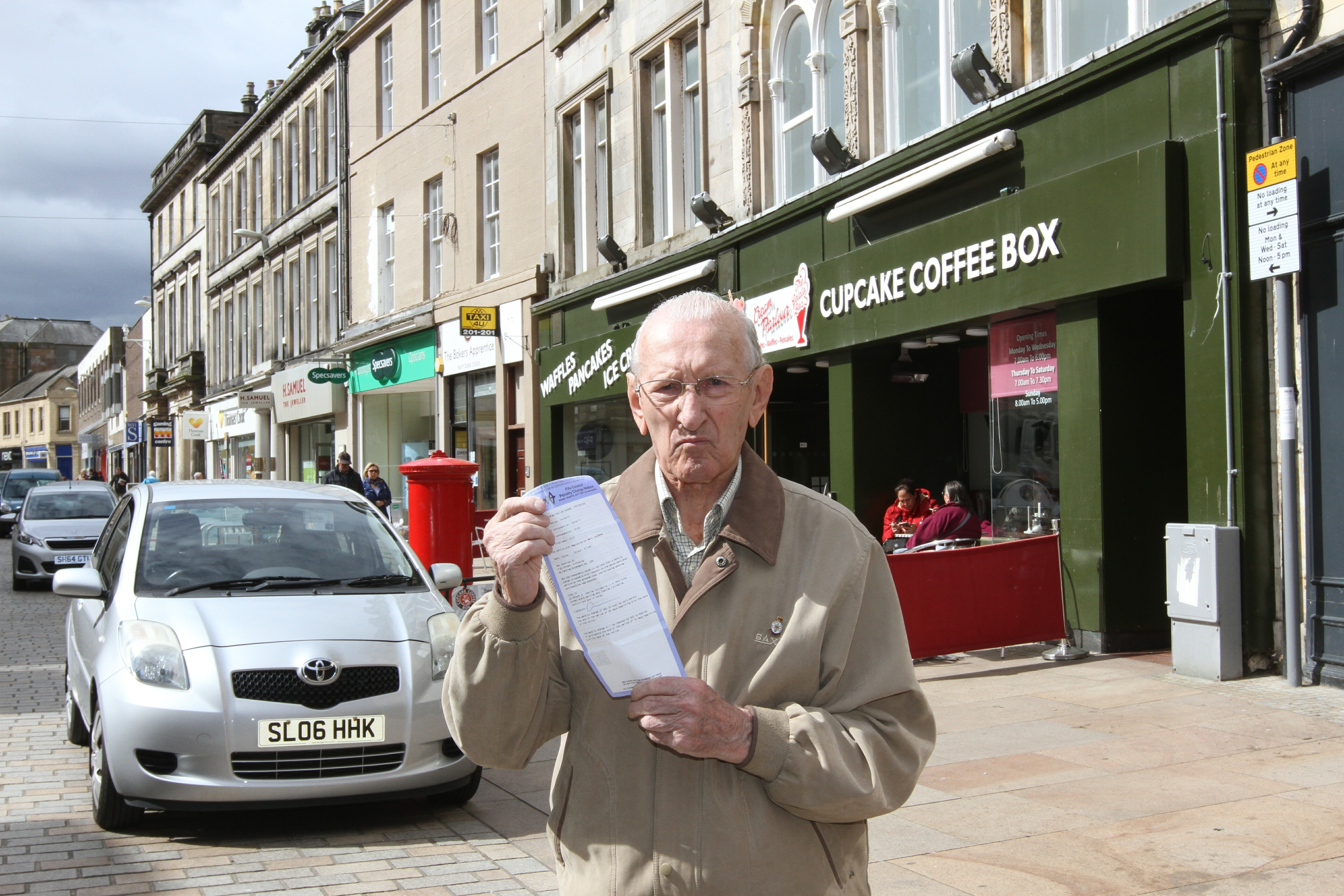 Tom Barnes, 91, in Kirkcaldy High Street, where he received his parking ticket.