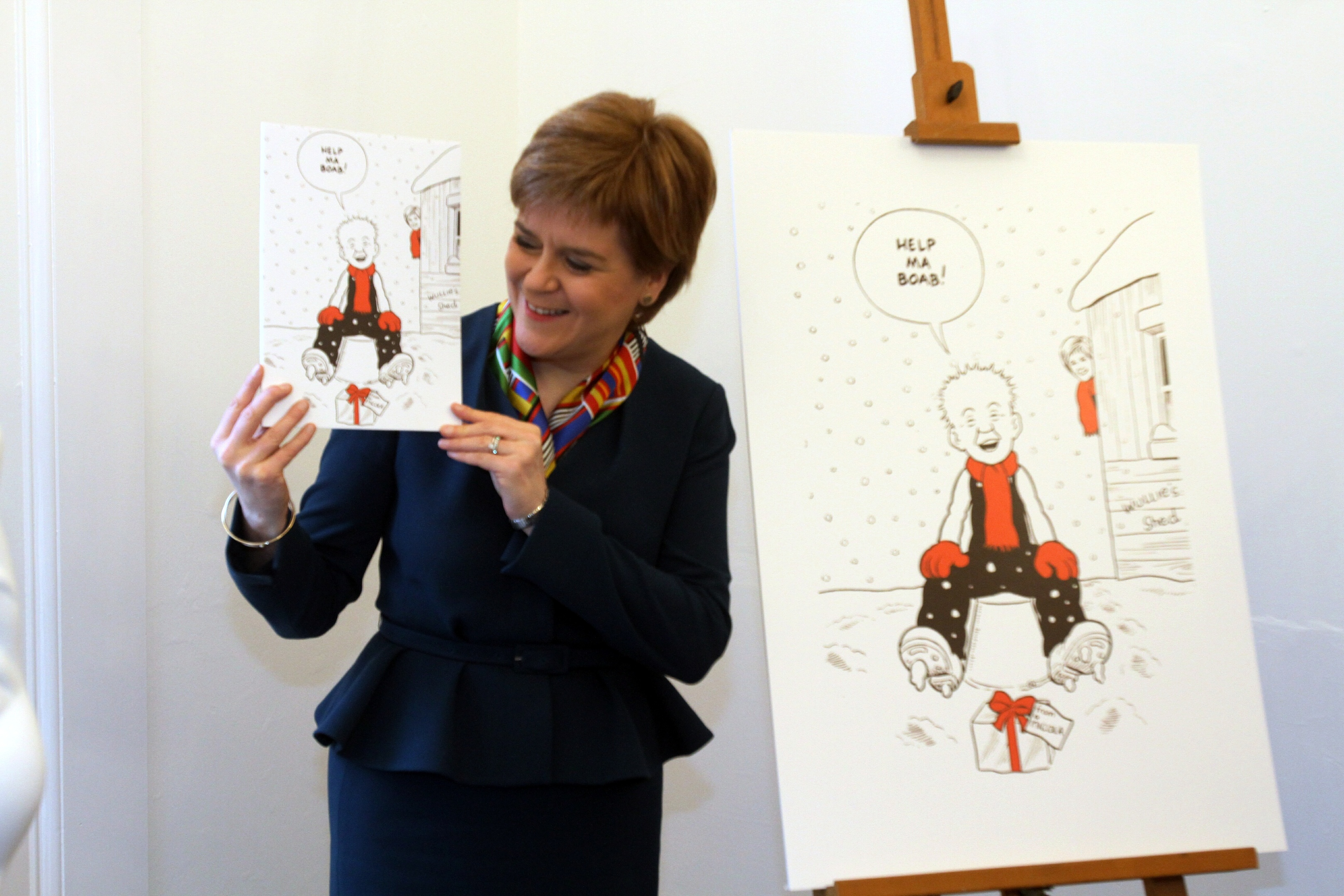 First Minister Nicola Sturgeon unveils her Oor Wullie Christmas card at The Vine in Dundee
