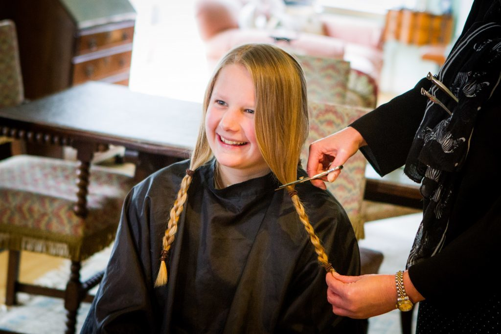 Grace Cameron, 12, getting her hair cut on Wednesday morning.
