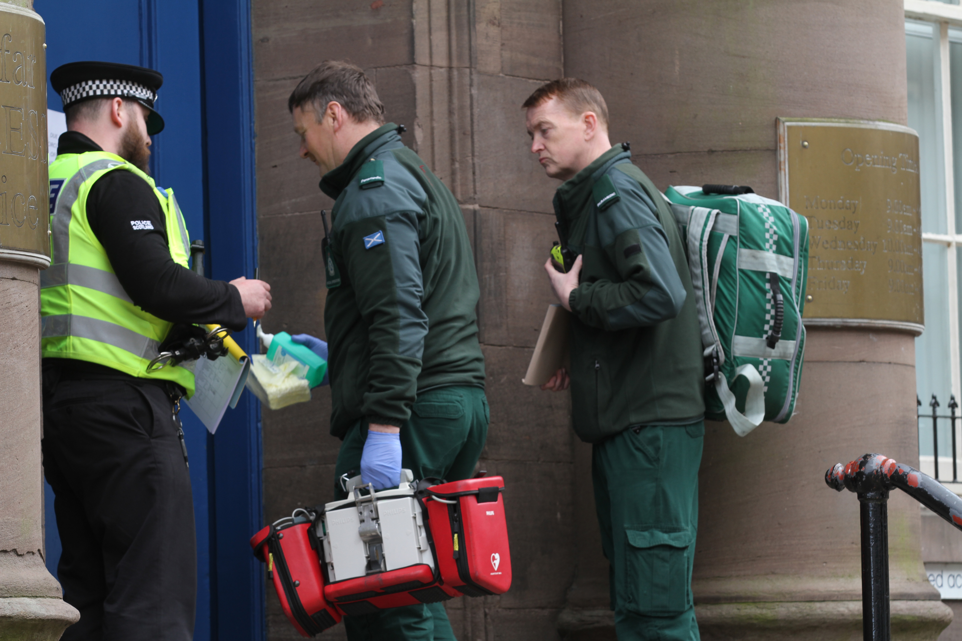 Paramedics entering the Municipal Buildings in Forfar on Wednesday afternoon.