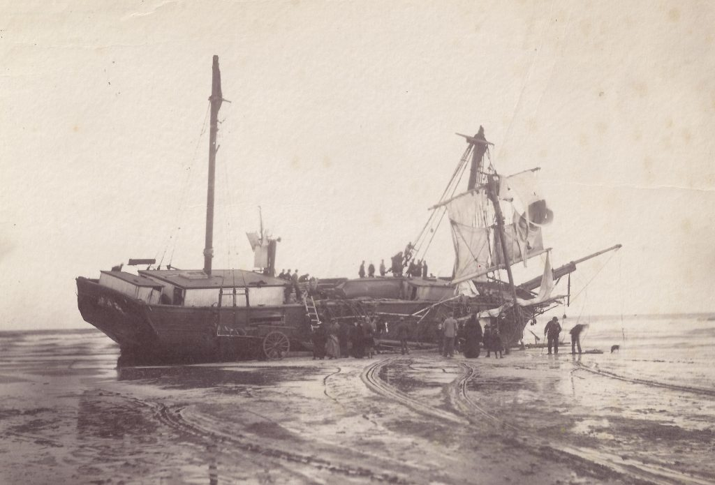 The wreck of the Wilhelm of Riga. Carrying coal from Boston to Memel she was driven ashore on the West Sands, St Andrews, in October 1898.