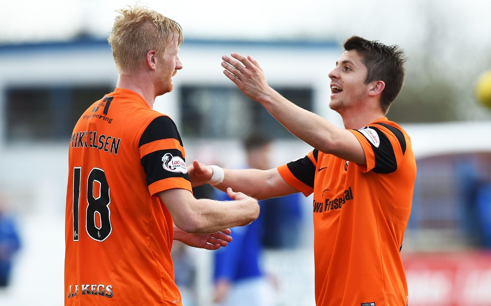 Thomas Mikkelsen is congratulated by Charlie Telfer after scoring his second goal.