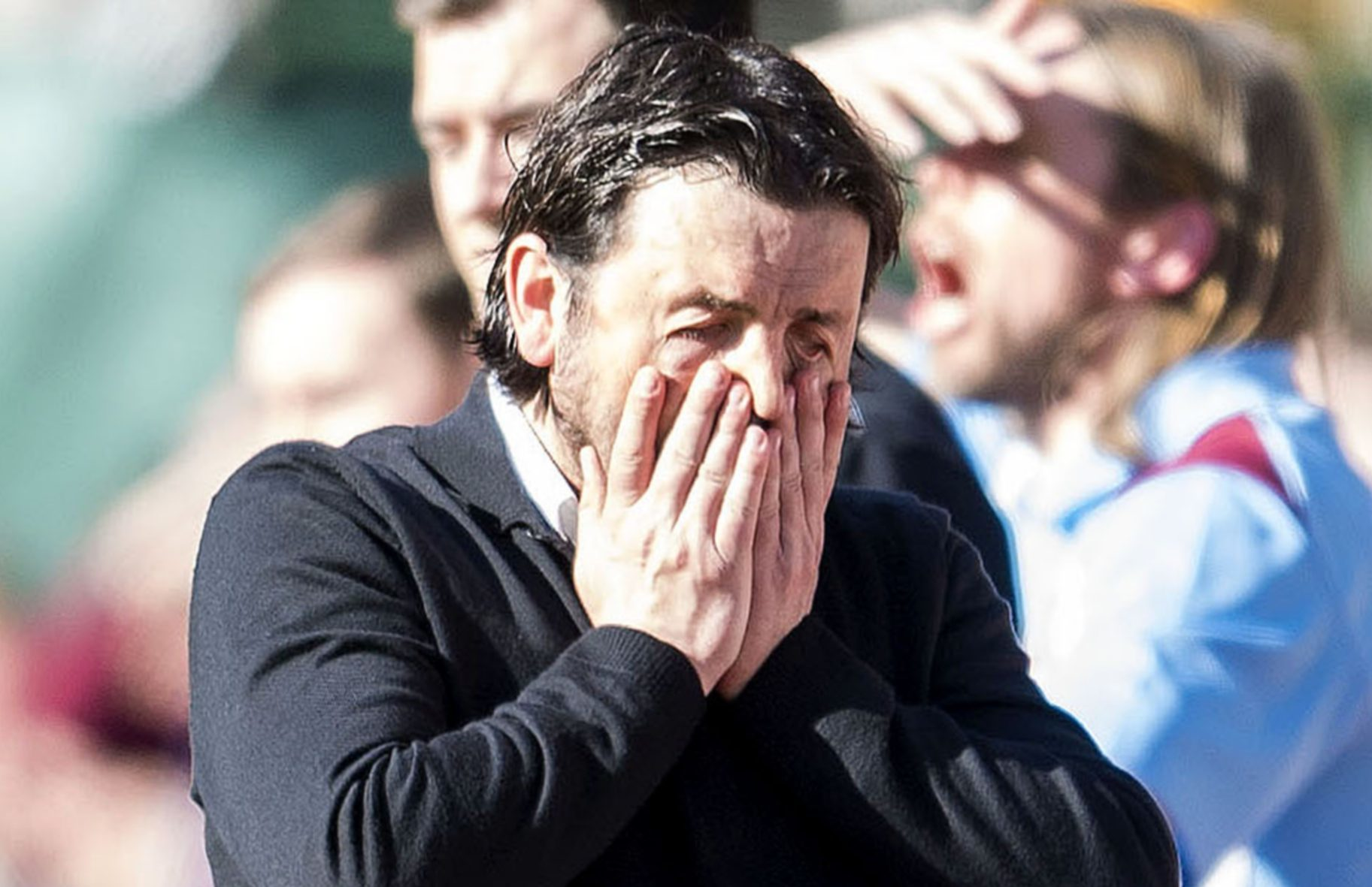 A dejected Paul Hartley at Tynecastle.