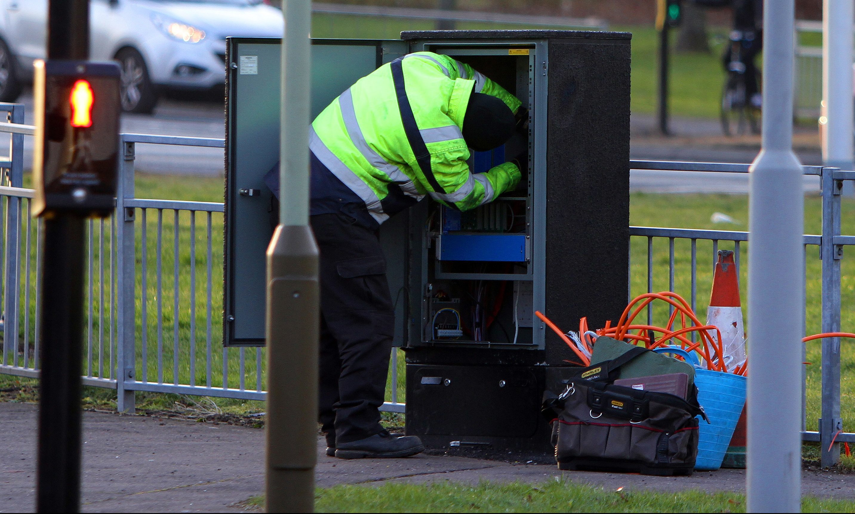 An engineer working on traffic light settings at Claypotts junction during a prvious fault.