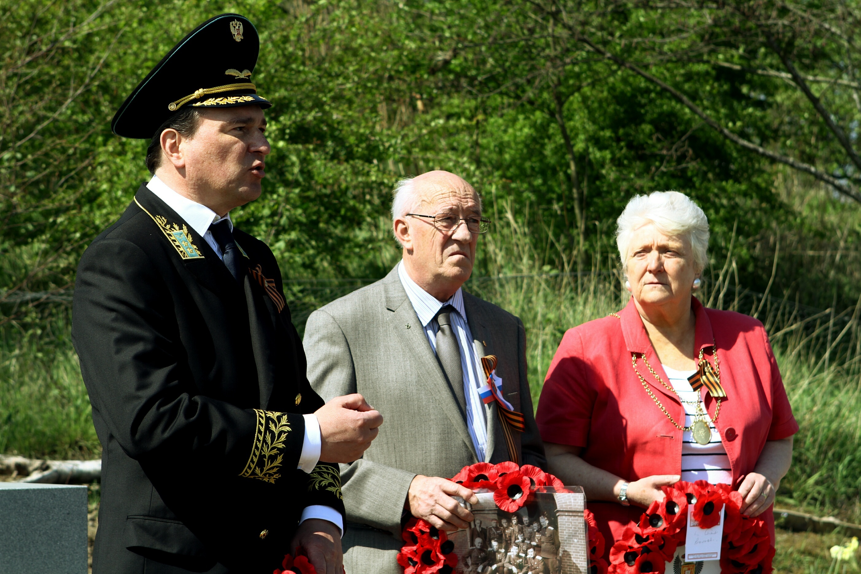 Last year's ceremony for the Russian airmen who were based at Errol Airfield L/R, Andrey Pritsepov - Consul General, Russian Federation in Edinburgh, Bradley Borland - aviation enthusiast and Perth Provost Liz Grant. Story by Perth office.