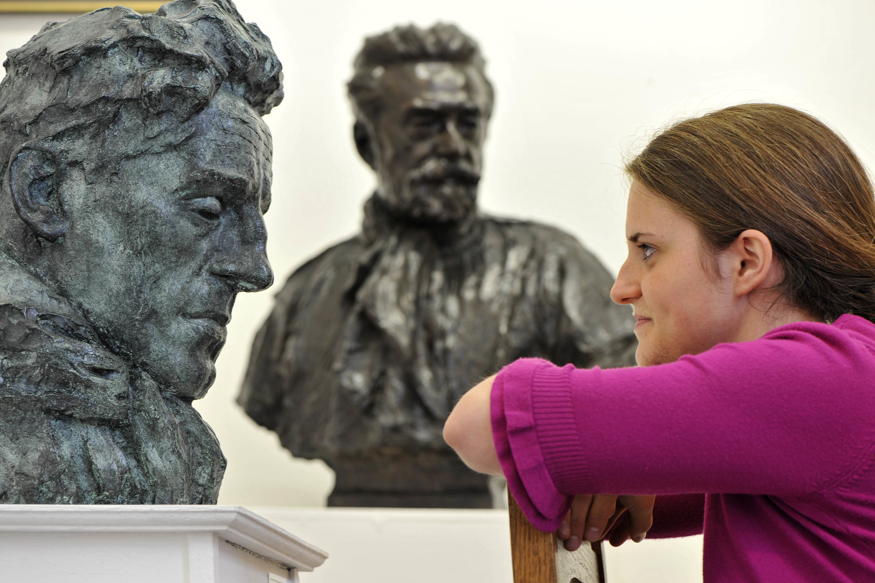 "Montrose curator Grace Ann Robertson is pictured with the William Lamb sculptures ""Bill"" and ""Dr Pittendreigh MacGillvray"""