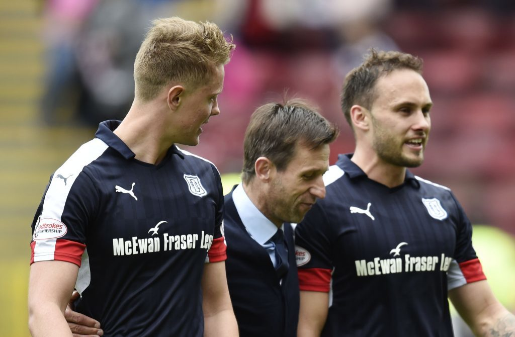 So far, so good. Dundee interim manager Neil McCann celebrates at full time with Mark O'Hara and Tom Hateley.