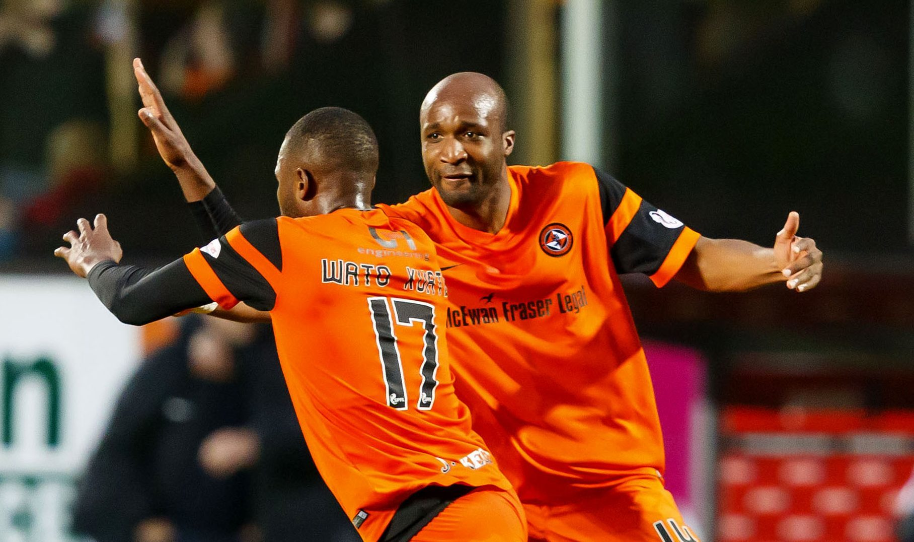 Wato Kuate celebrates his goal with William Edjenguele.