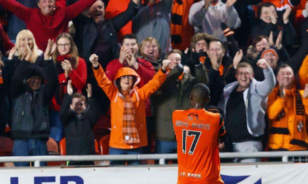 Wato Kuate celebrates his goal with the fans.
