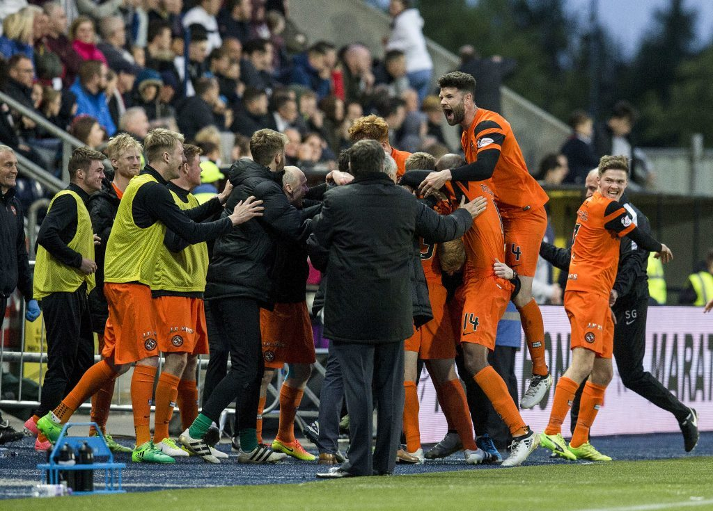 Paul DIxon celebrates with the travelling United support.