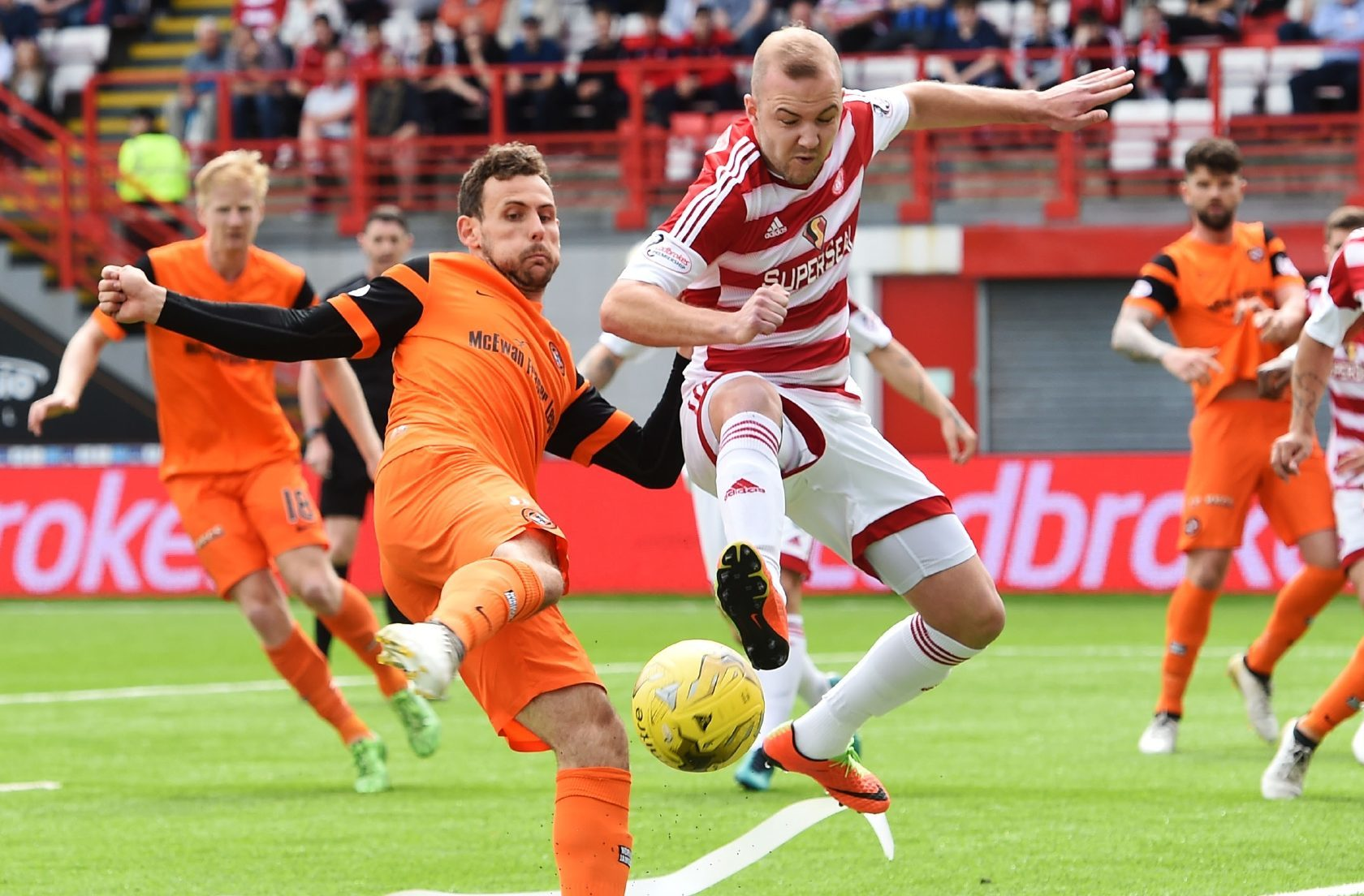 Tony Andreu tries to get a shot in for United.