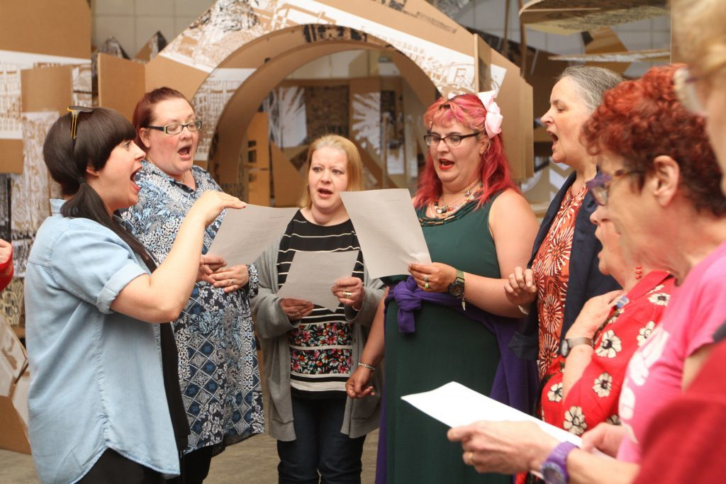 Alice Marra leads the Singer Machine Choir on Friday night.