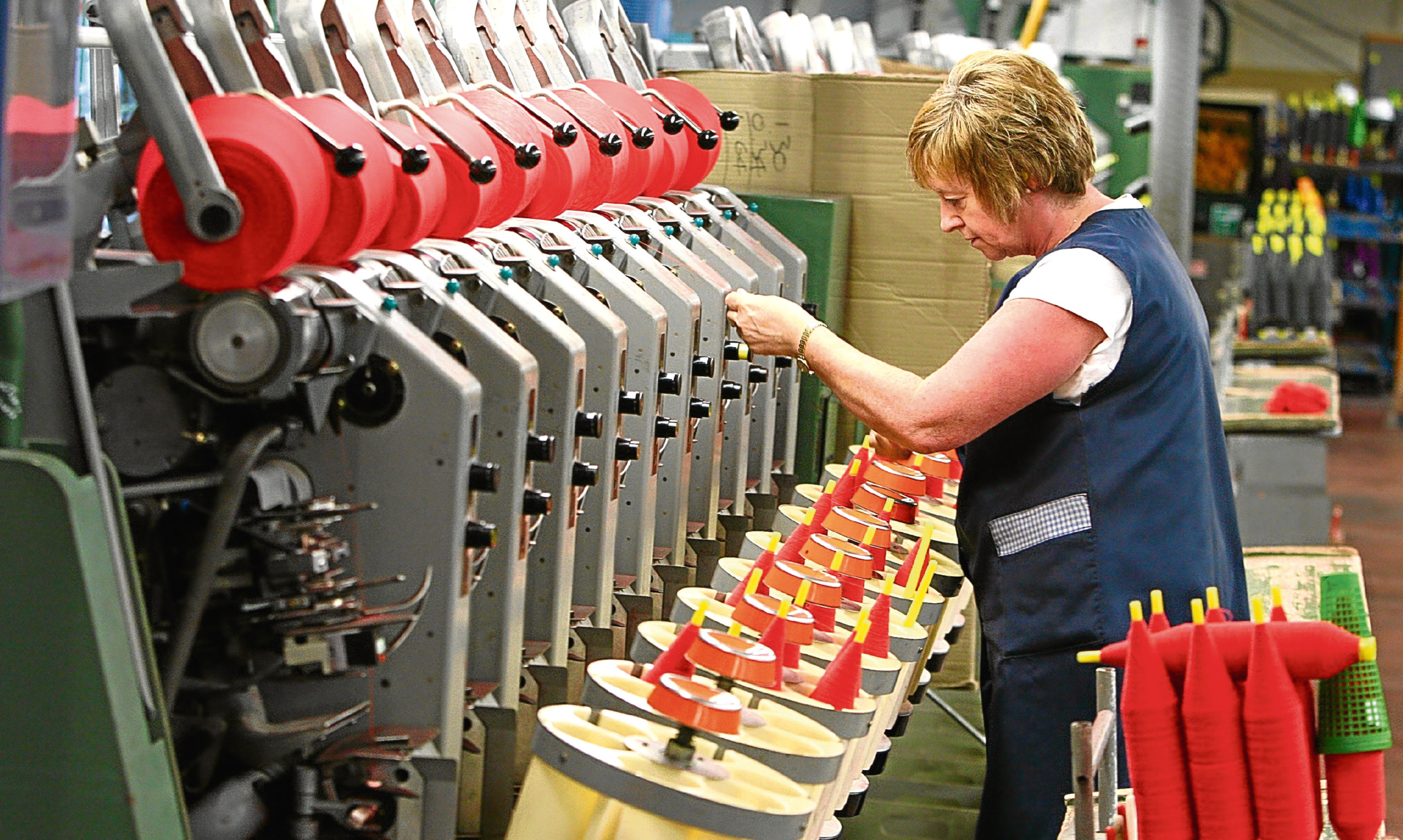 A worker involved in the cashmere yarn manufacturing process at Todd & Duncan of Kinross.