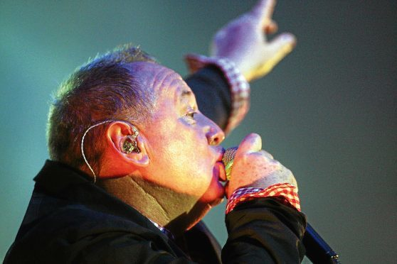 Jim Kerr on stage.