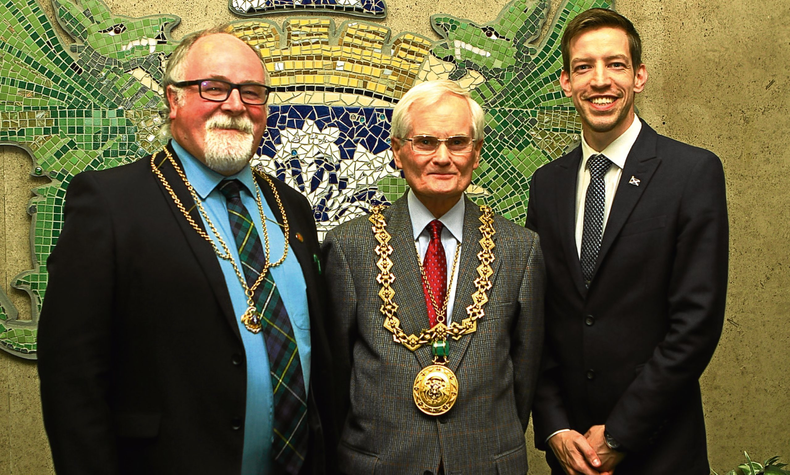 The new lord provost of Dundee Ian Borthwick, centre, with depute lord provost Bill Campbell, left, and administration leader John Alexander.