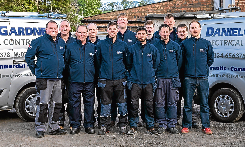 Daniel Gardner (centre, back) with members of his team