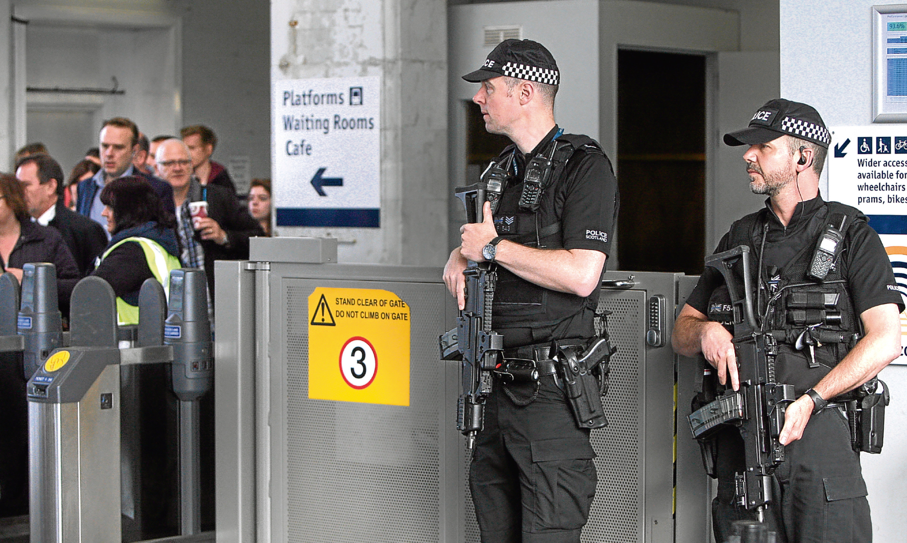Armed police officers on duty at Dundee railway station in May following the Manchester terror attack.