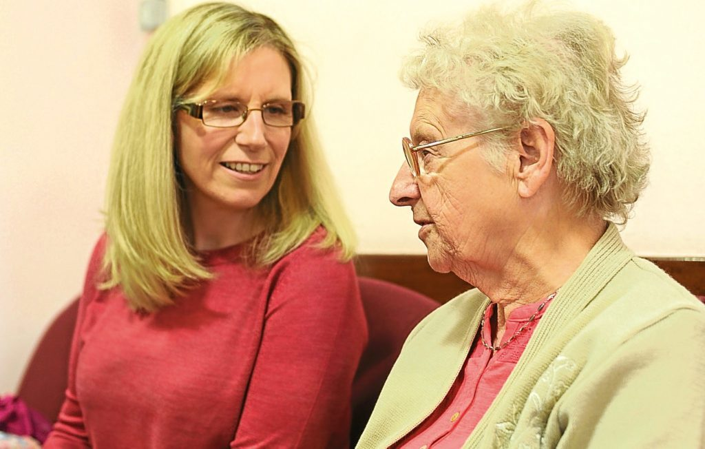 Lesley Brennan chatting to a pensioner in Dundee East.