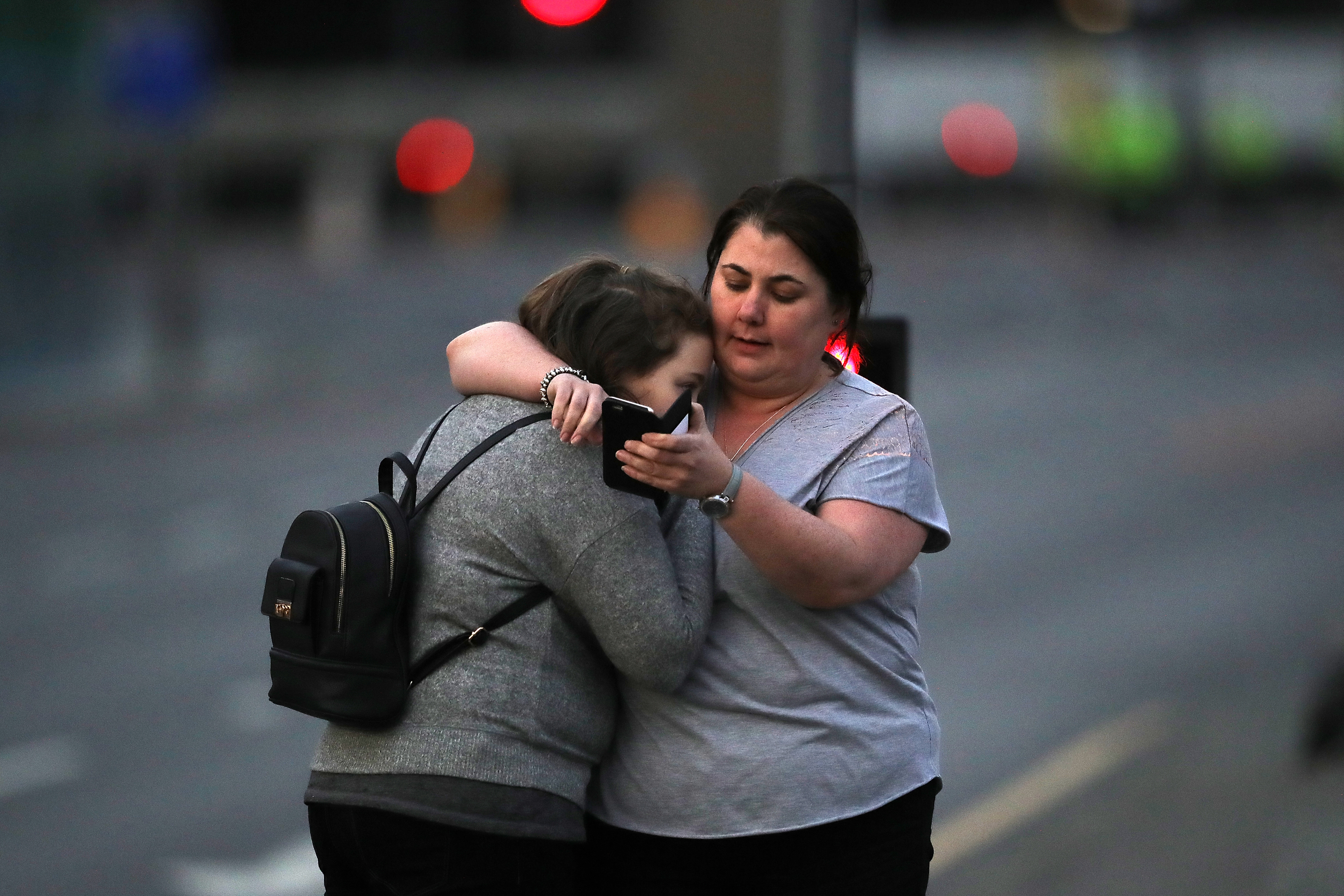 Ariana Grande concert attendees Vikki Baker and her daughter Charlotte, aged 13, leave the Park Inn where they were given refuge after last night's explosion.