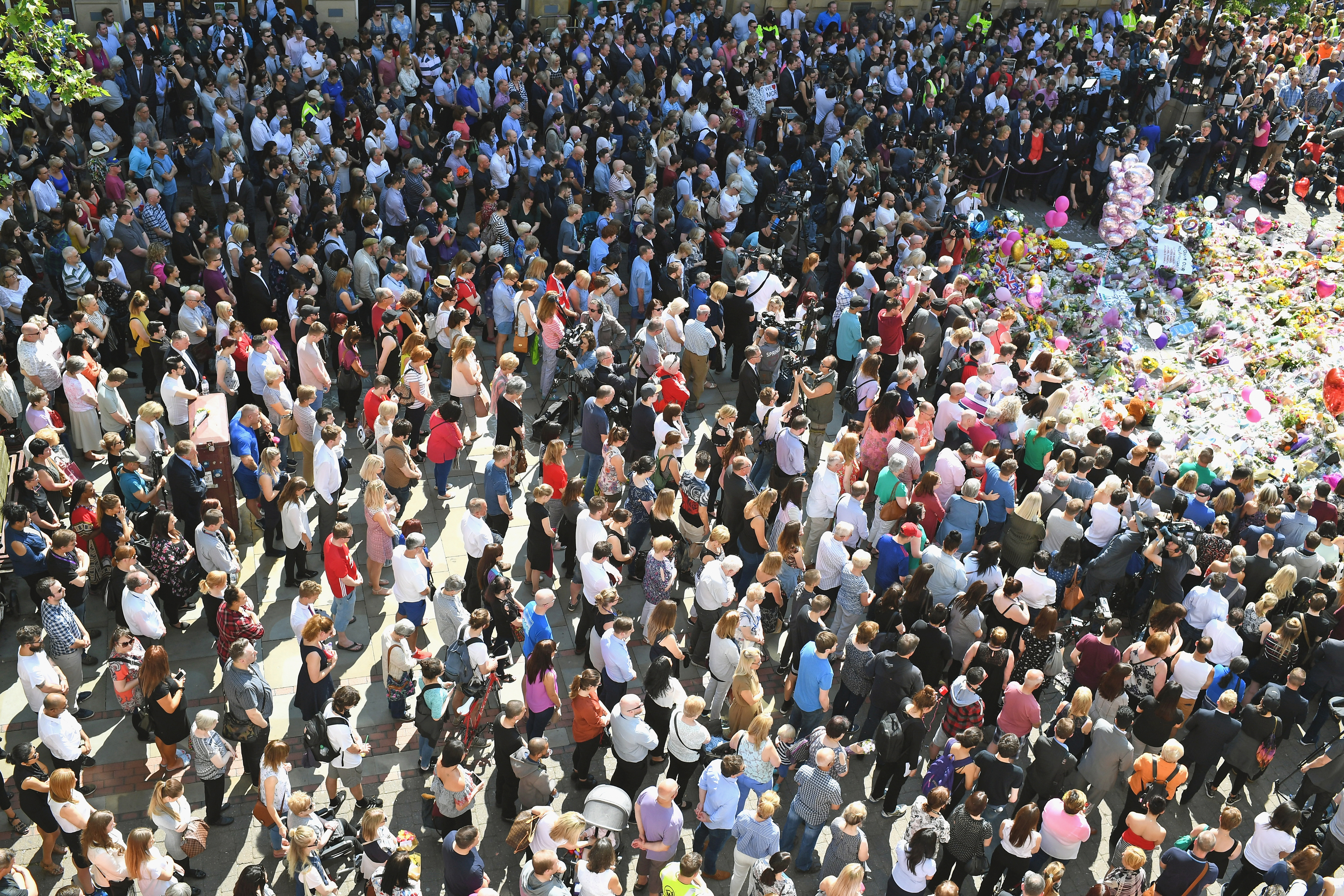 Members of the public in Manchester observe a national minute's silence in remembrance of all those who lost their lives in the Manchester Arena attack.