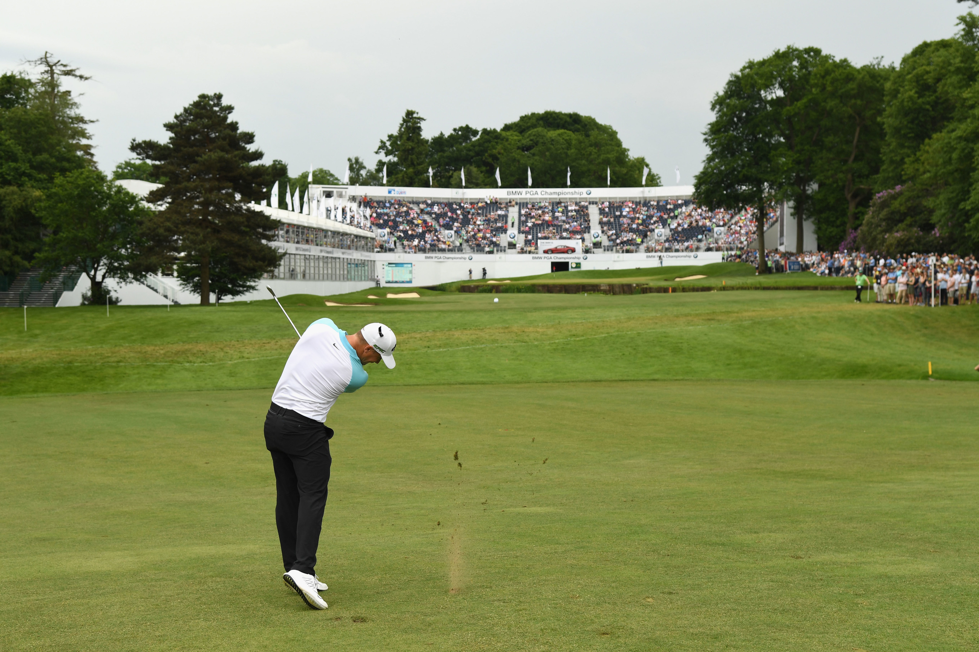 Alex Noren hits his second shot into the 18th at Wentworth during Sunday#s final round.