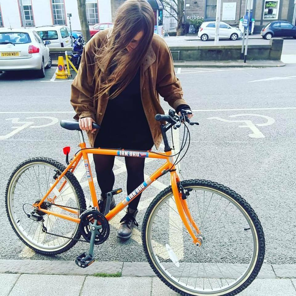 Abbie Lois Cartmell with her beloved Irn Bru bike before the theft.