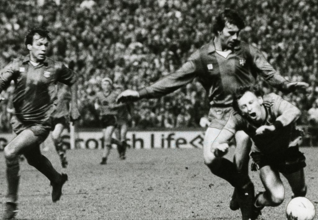 Paul Sturrock in action against Barcelona.