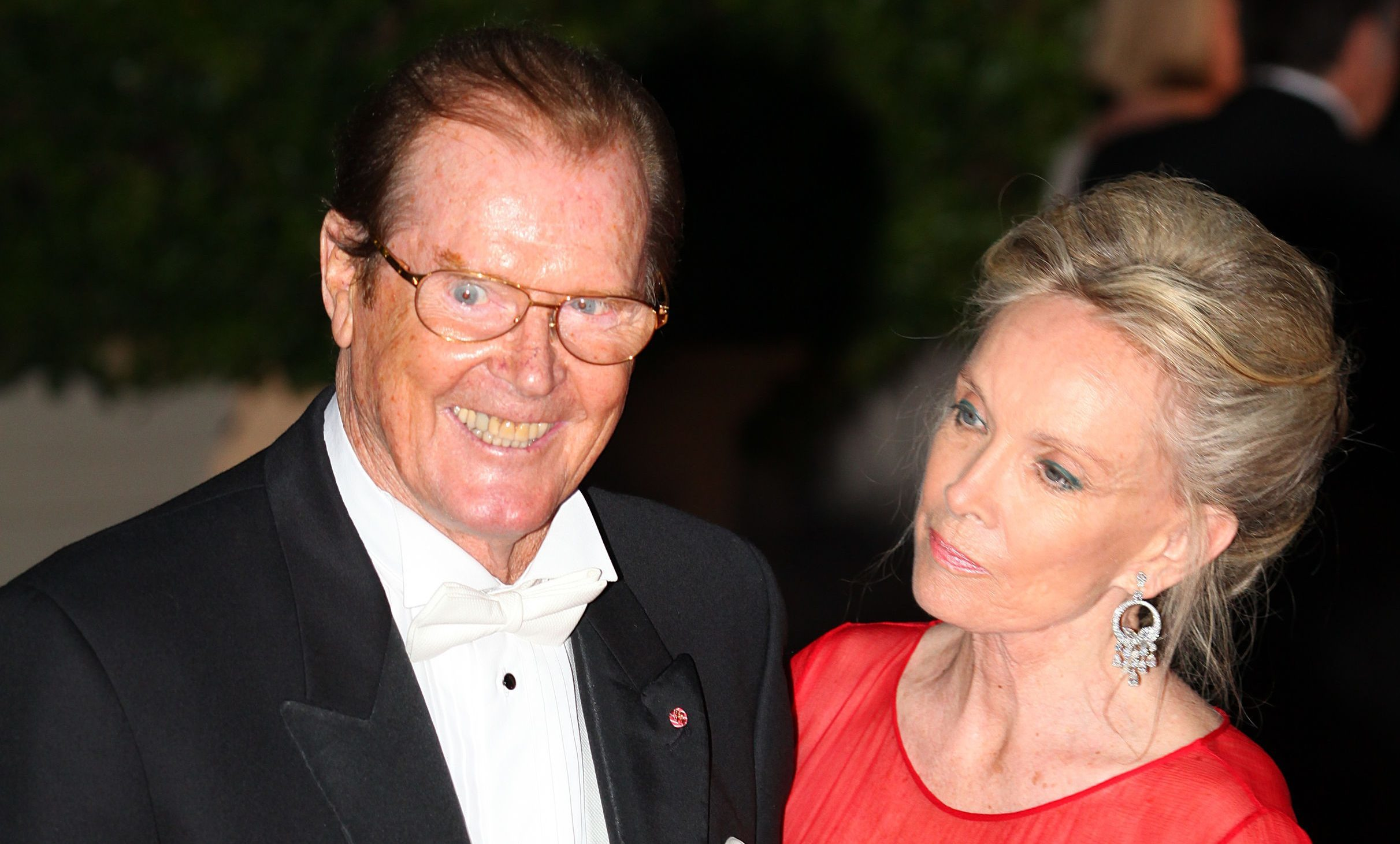 Sir Roger Moore and wife Kristina in 2011.