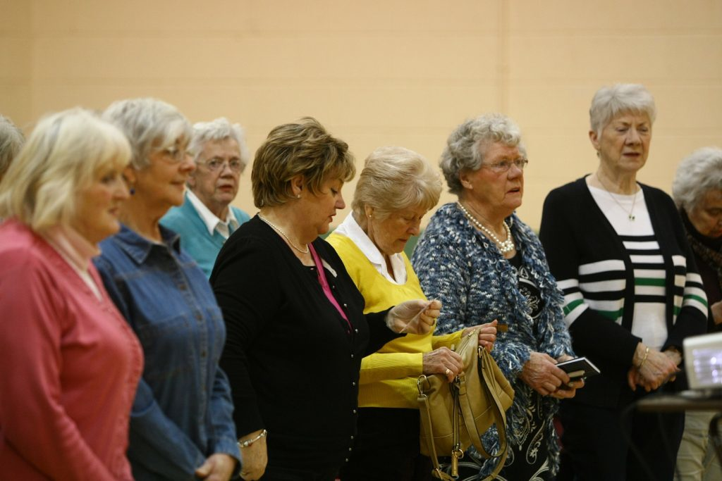 Singing the SWI song opens every meeting.