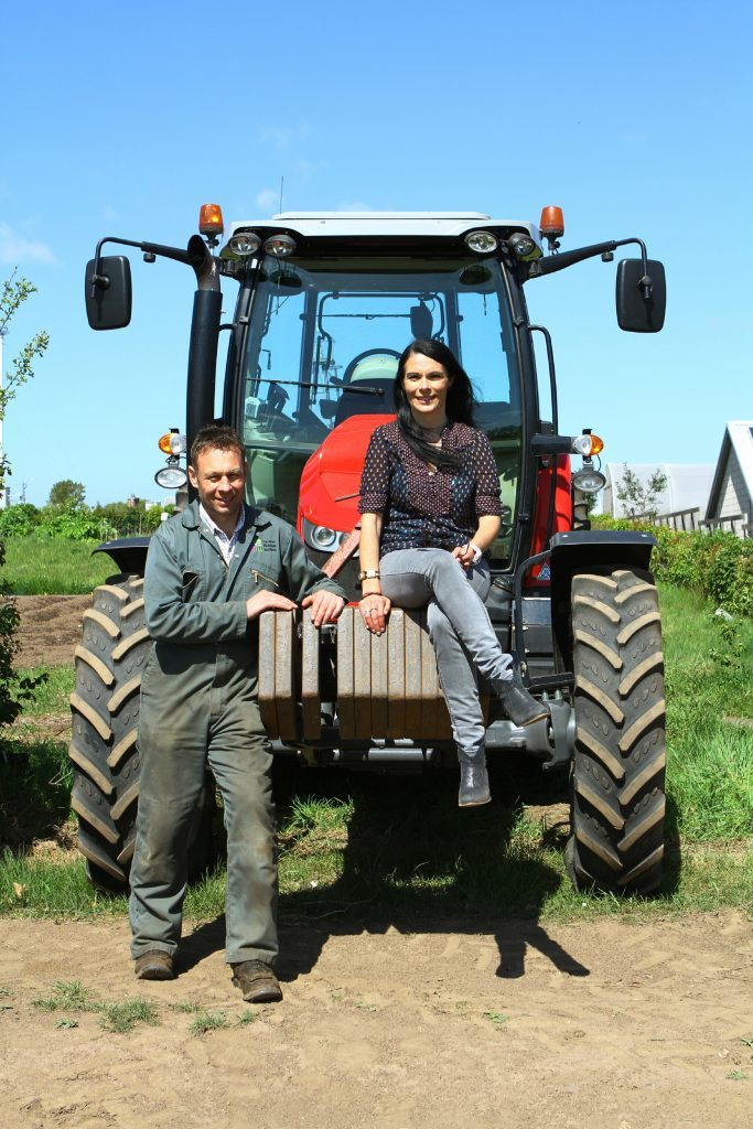 Gayle and Euan hanging out with a tractor.