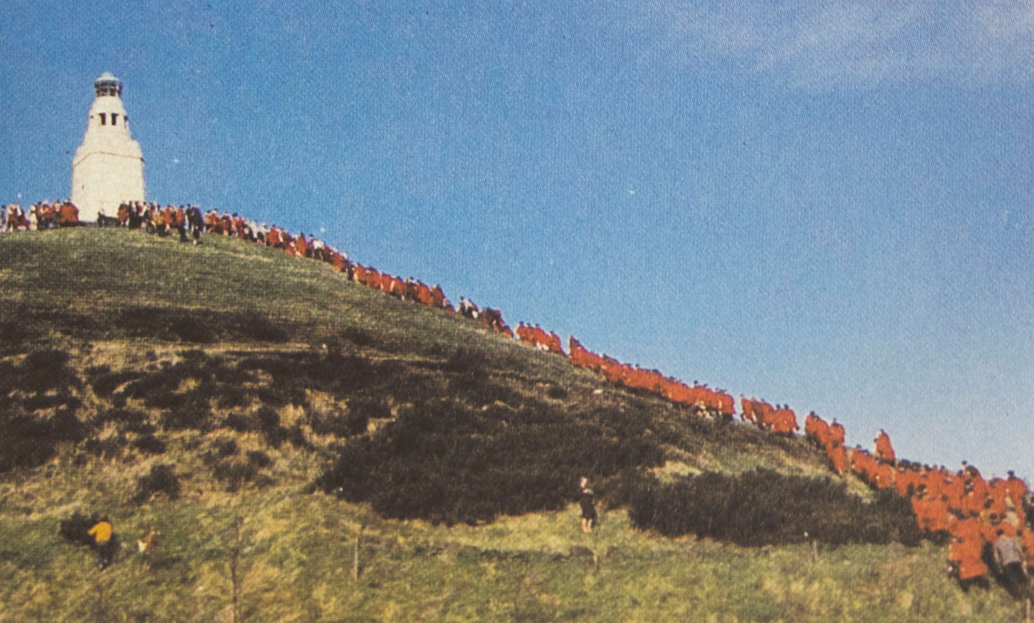 Students wearing red St Andrews gowns march up Dundee Law - and return with them removed to symbolise independence from St Andrews!