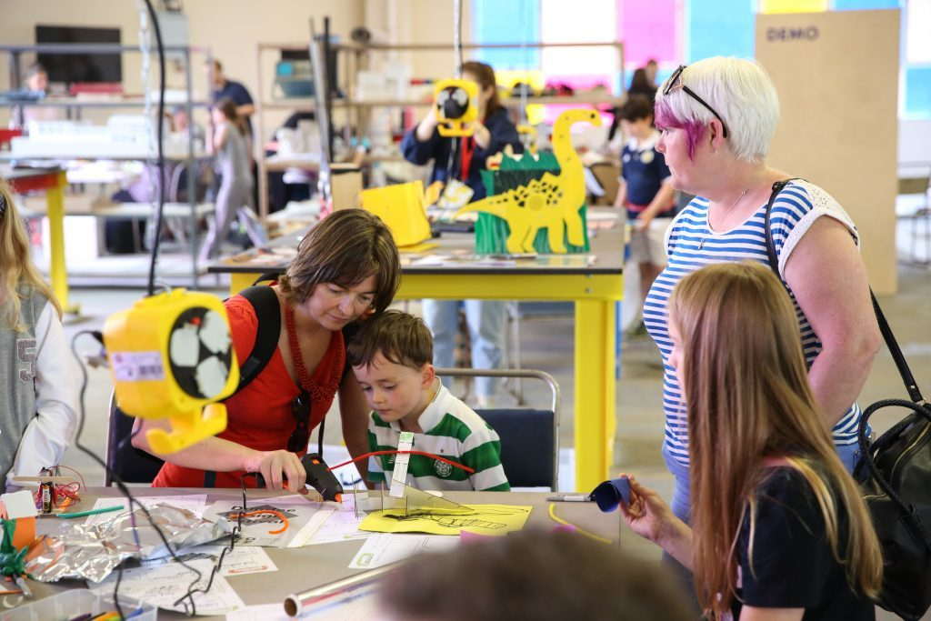 A family taking part in the Ardler Inventor Project workshop at the Dundee Design Festival.