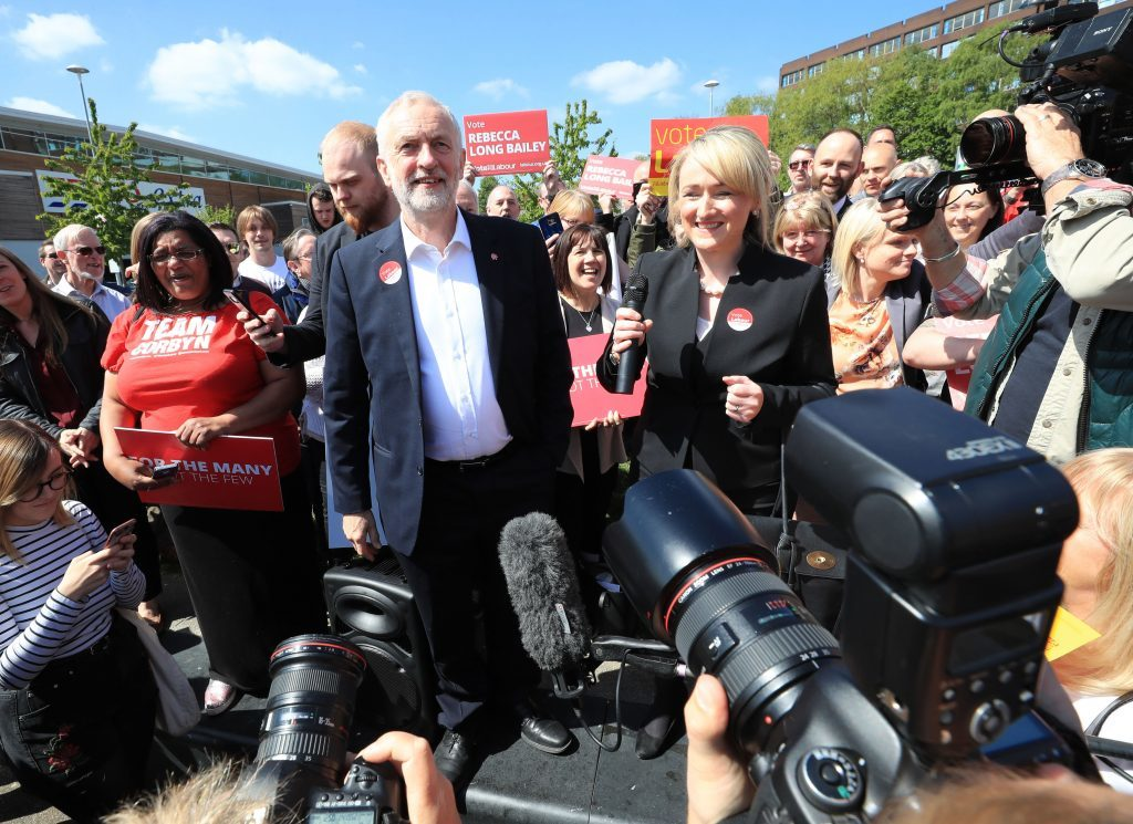 Labour leader Jeremy Corbyn with local candidate Rebecca Long-Bailey after getting off his battlebus as he arrives in Salford for a general election campaign stop.