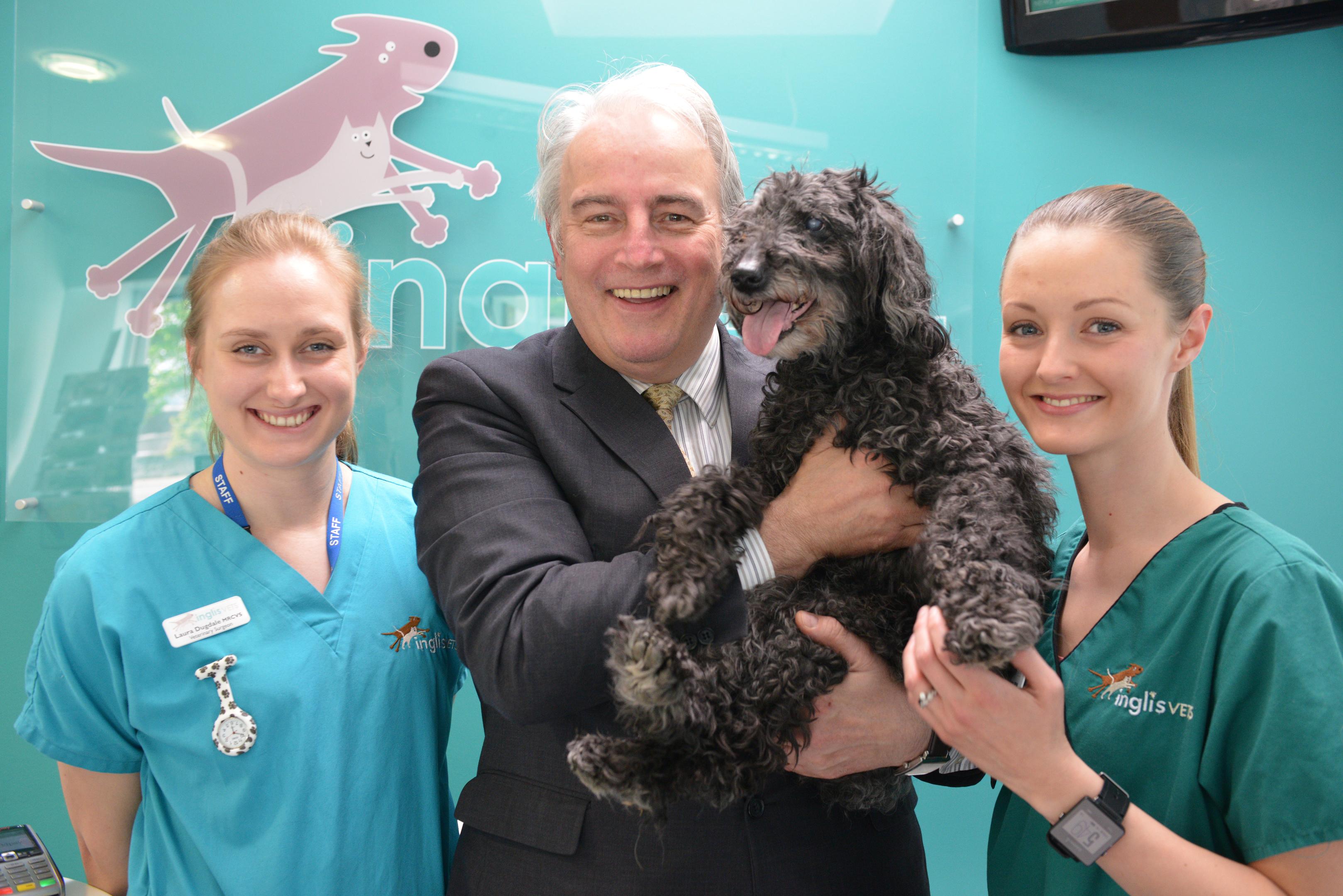 Vet Laura Dugdale,  Ian with his dog Taz and Martha McShane.
