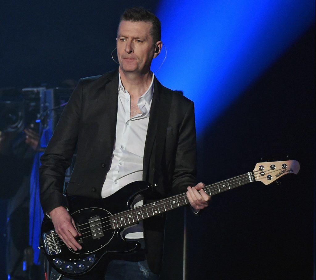 Ged Grimes playing with Simple Minds.