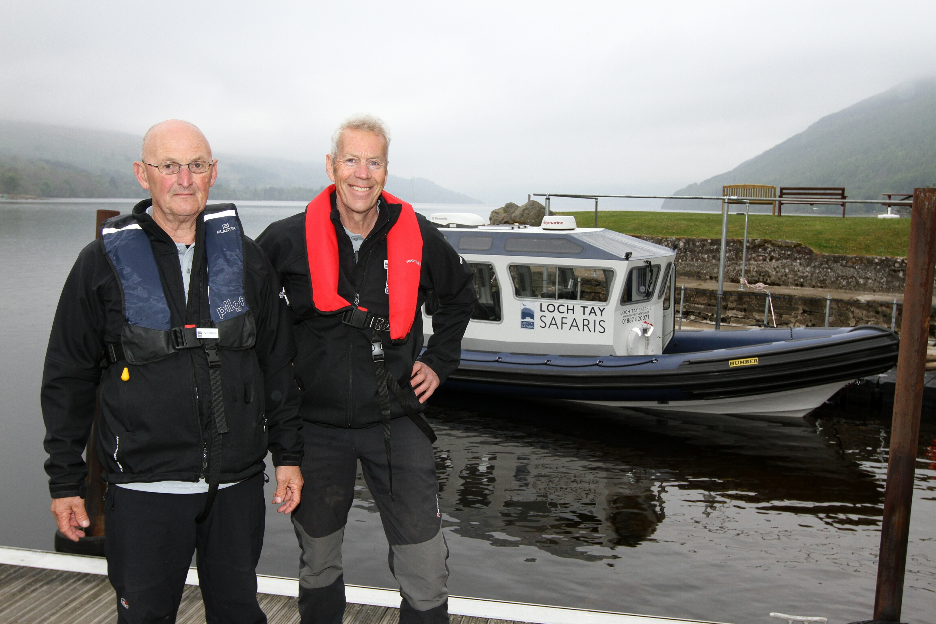 Norman Brett and owner Donald Riddell  on the boat on the loch.