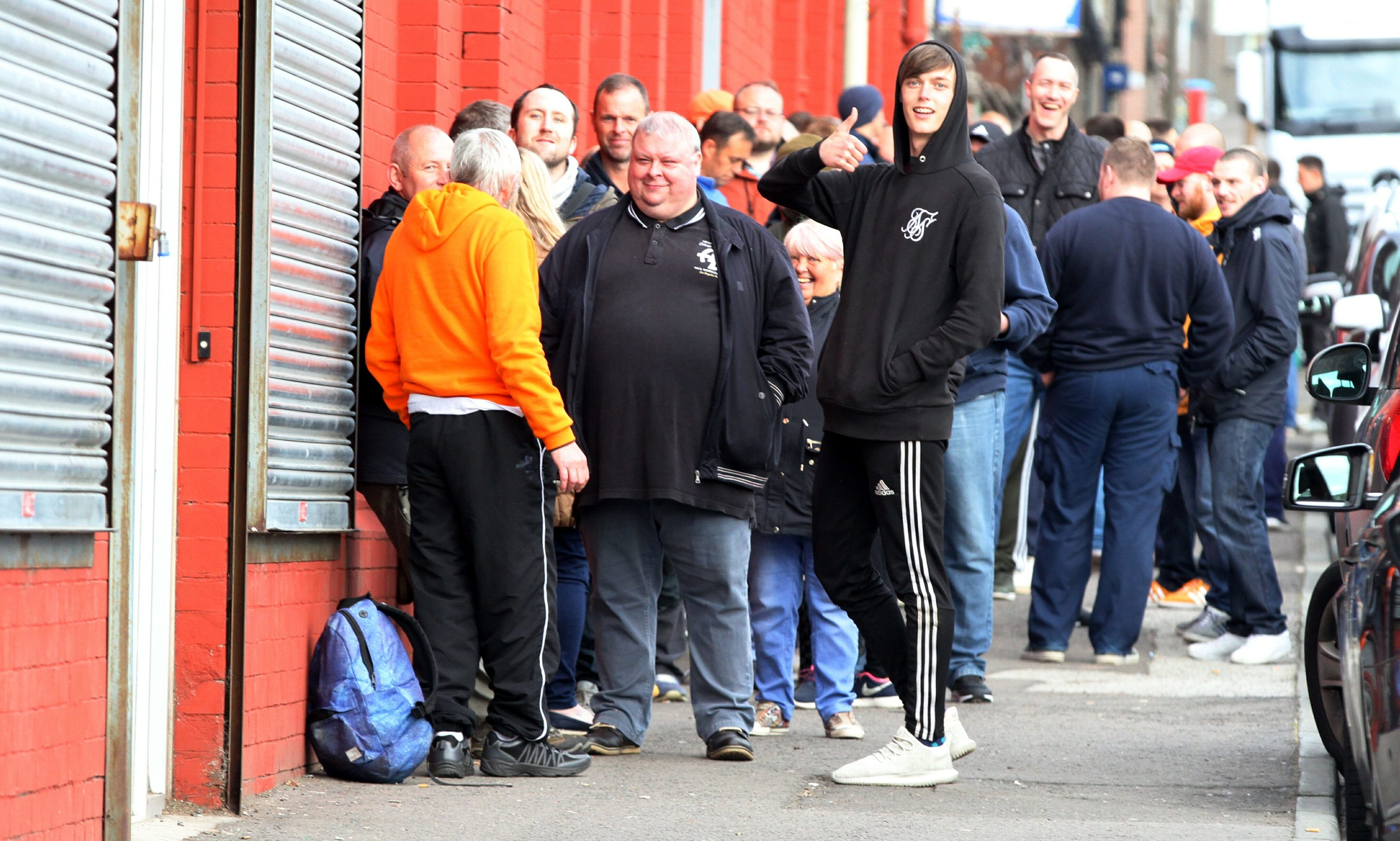 United fans waiting for the club shop to open for ticket sales.