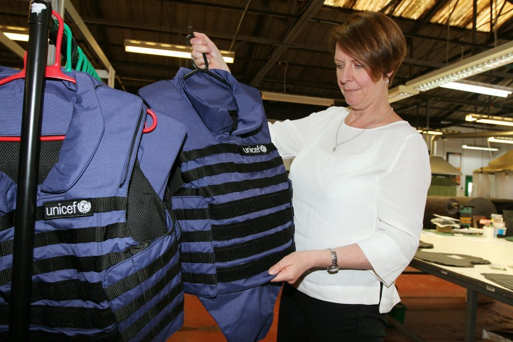 Kate Clark checking one of the UNICEF protective jackets at J&D Wilkie, Kirriemuir
