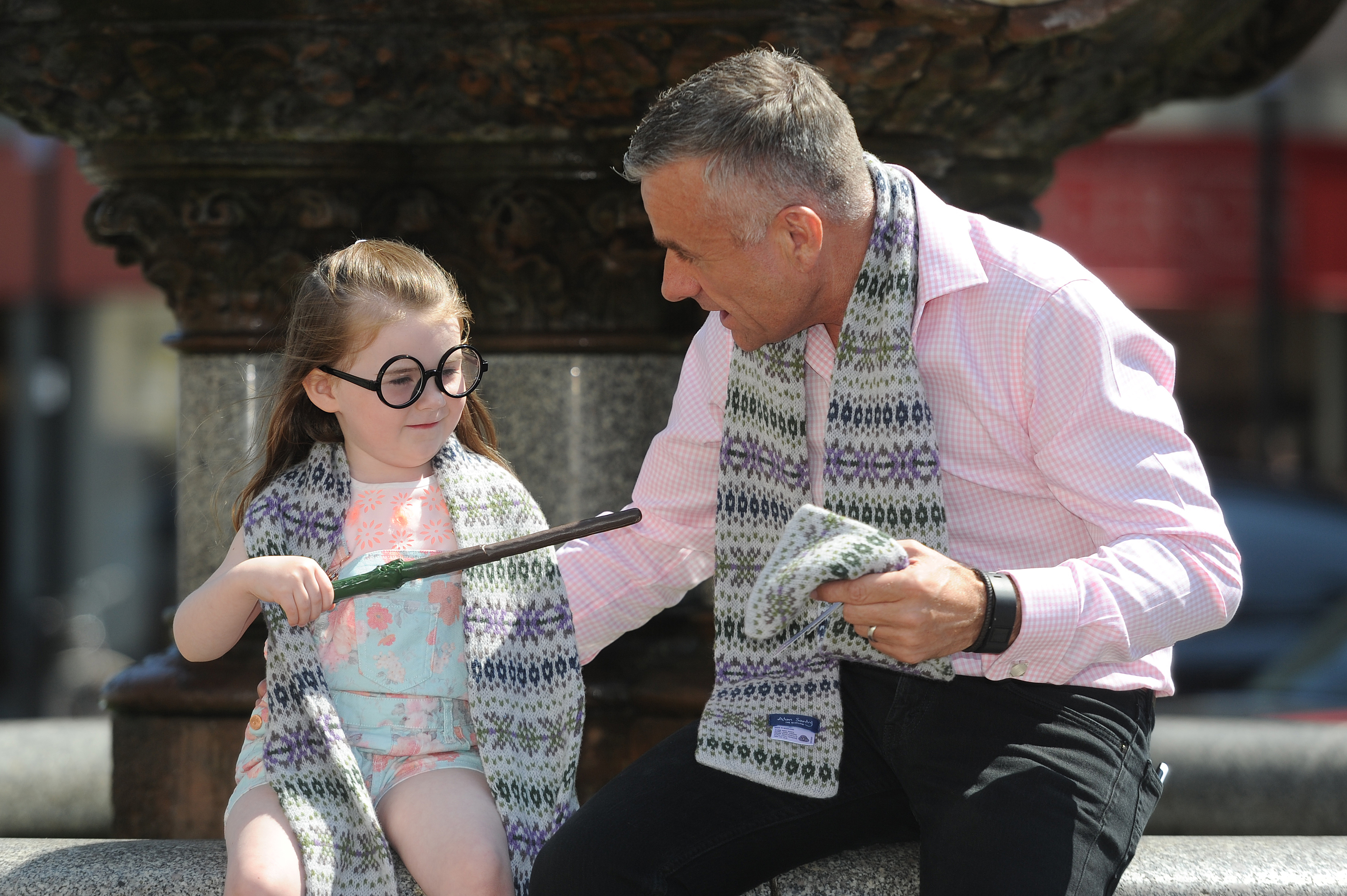 Leah Murphy, 4, models the 'Harry Potter' scarf with Kirkcaldy-based maker Alan Santry, at the launch of VisitScotland shop local campaign. The scarf, worn by Hermione Grainger has become a bestseller at VisitScotland iCentres but was originally only stocked in the St Andrews branch.