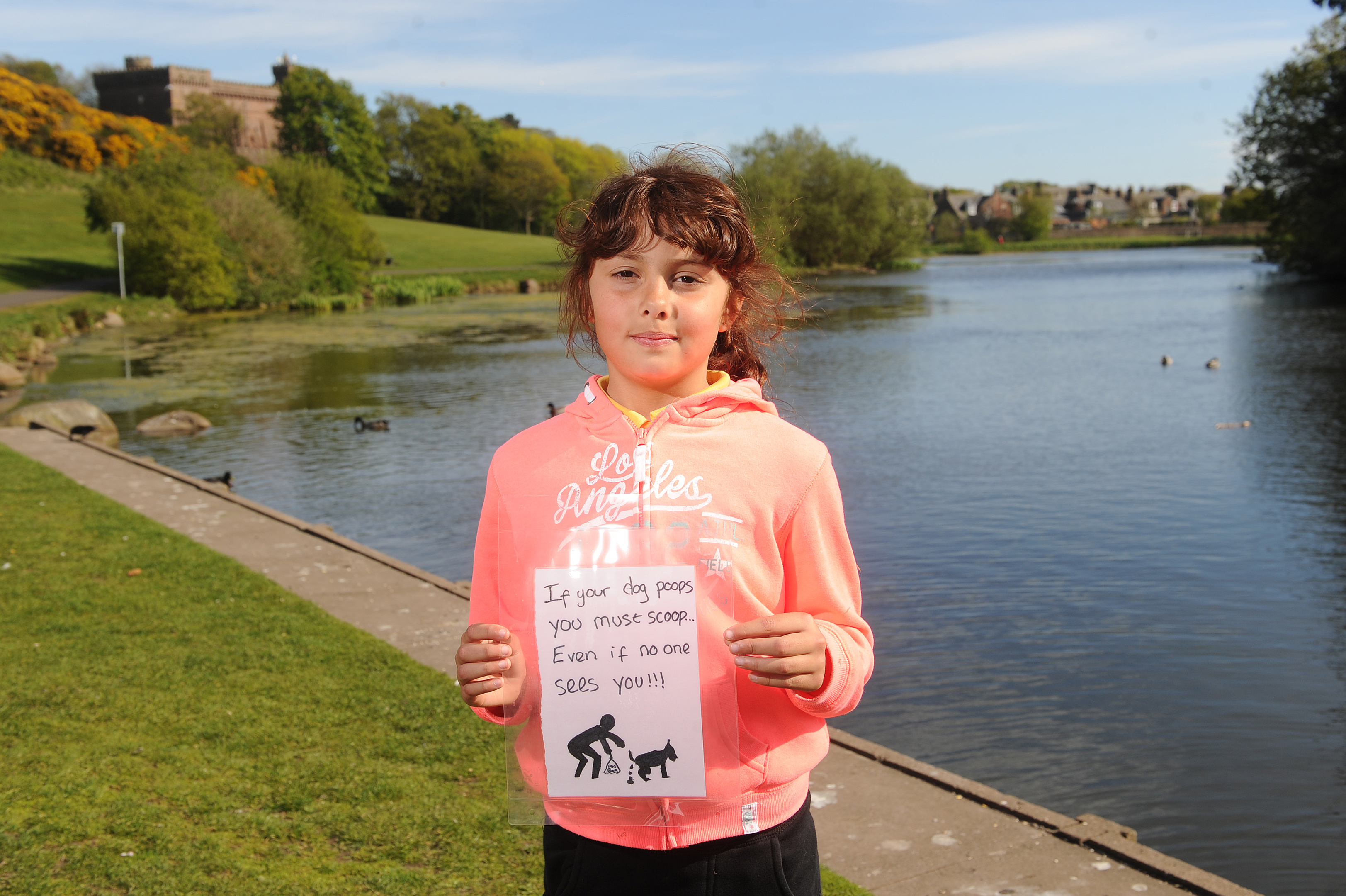 Chloe Todd, young eco-warrior and Keptie Friends member, with her poster.