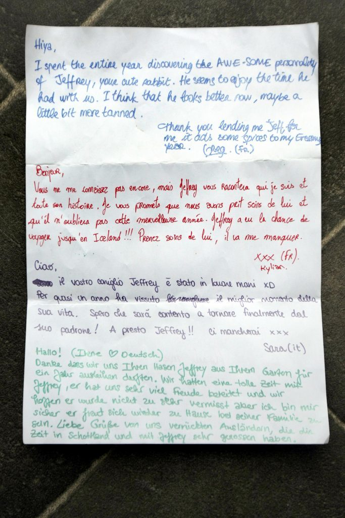 Courier News. Perth Story. Fiona McWilliams had her rabbit ornament stolen from her garden in Perth. A year later it was returned with a note in four languages indicating he had been travelling (including to Iceland). Picture shows; the letter that accompanied 'Geoffrey' back home in the garden. Wednesday, 10th May, 2017.