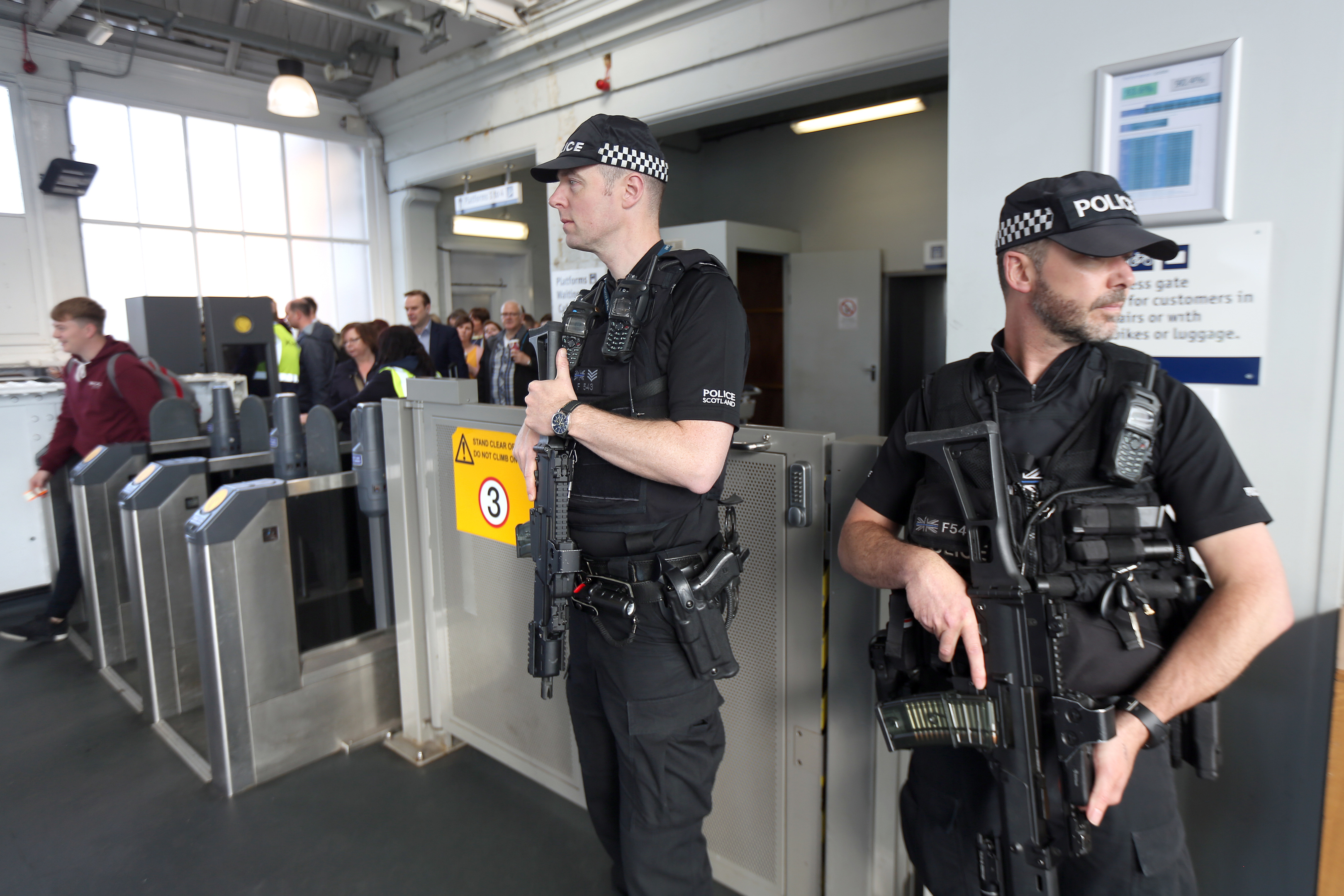 Armed police on guard as commuters arrive at Dundee railway station.