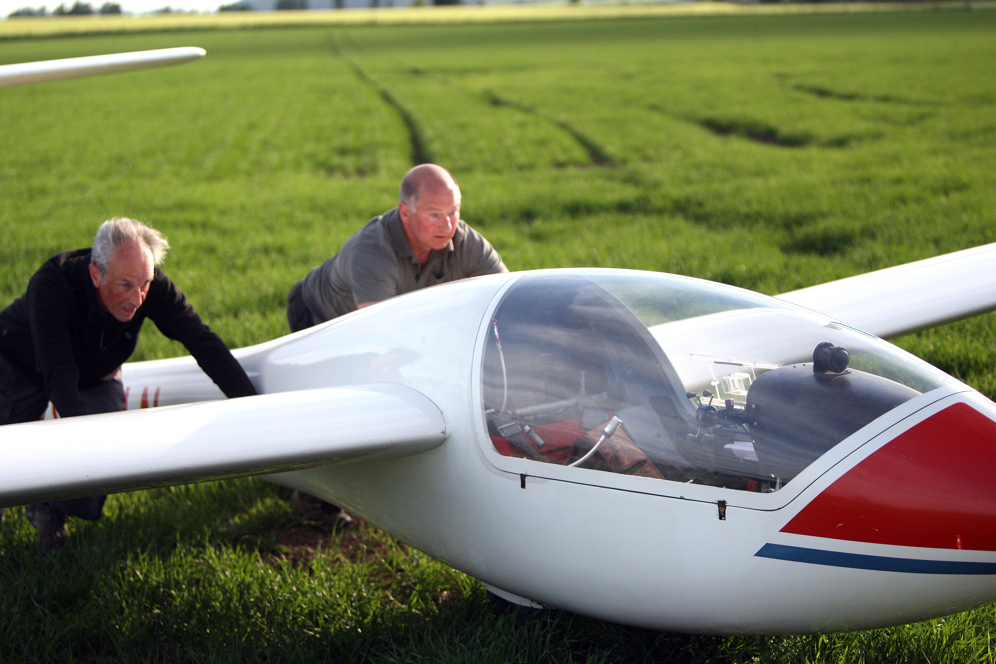 Members of the Bowland Forest Gliding Club help recover the glider.