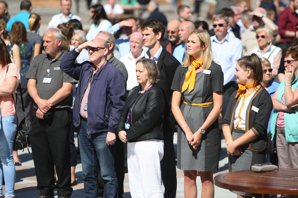 People gather in Dundee to pay tribute to the victims of the Manchester attack.