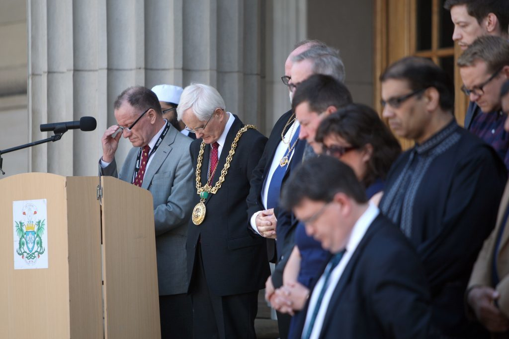 Lord Provost Ian Borthwick and other senior figures observing the silence.