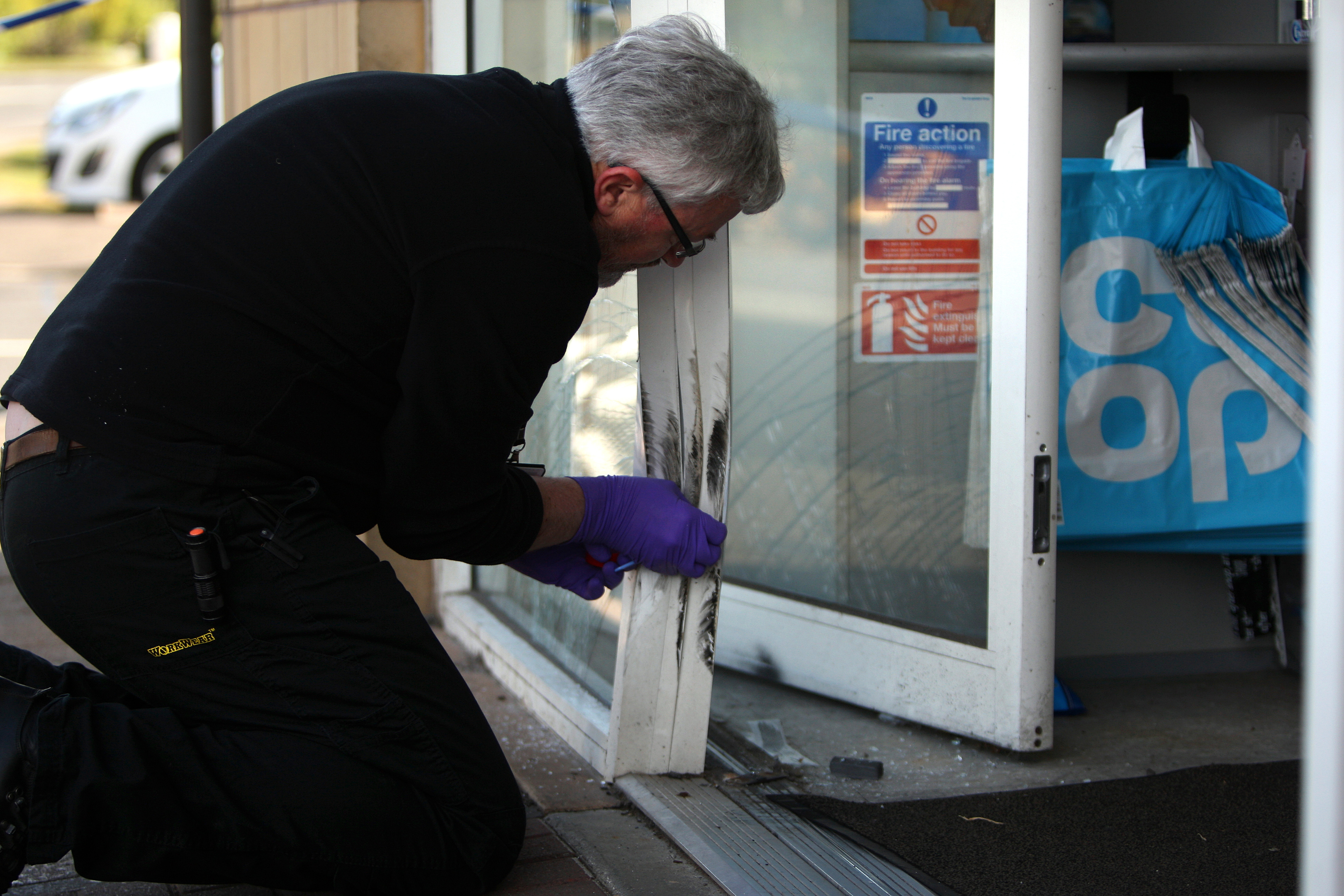 Police investigate the incident at the Co-Op store at Panmurefield Village, Dundee.