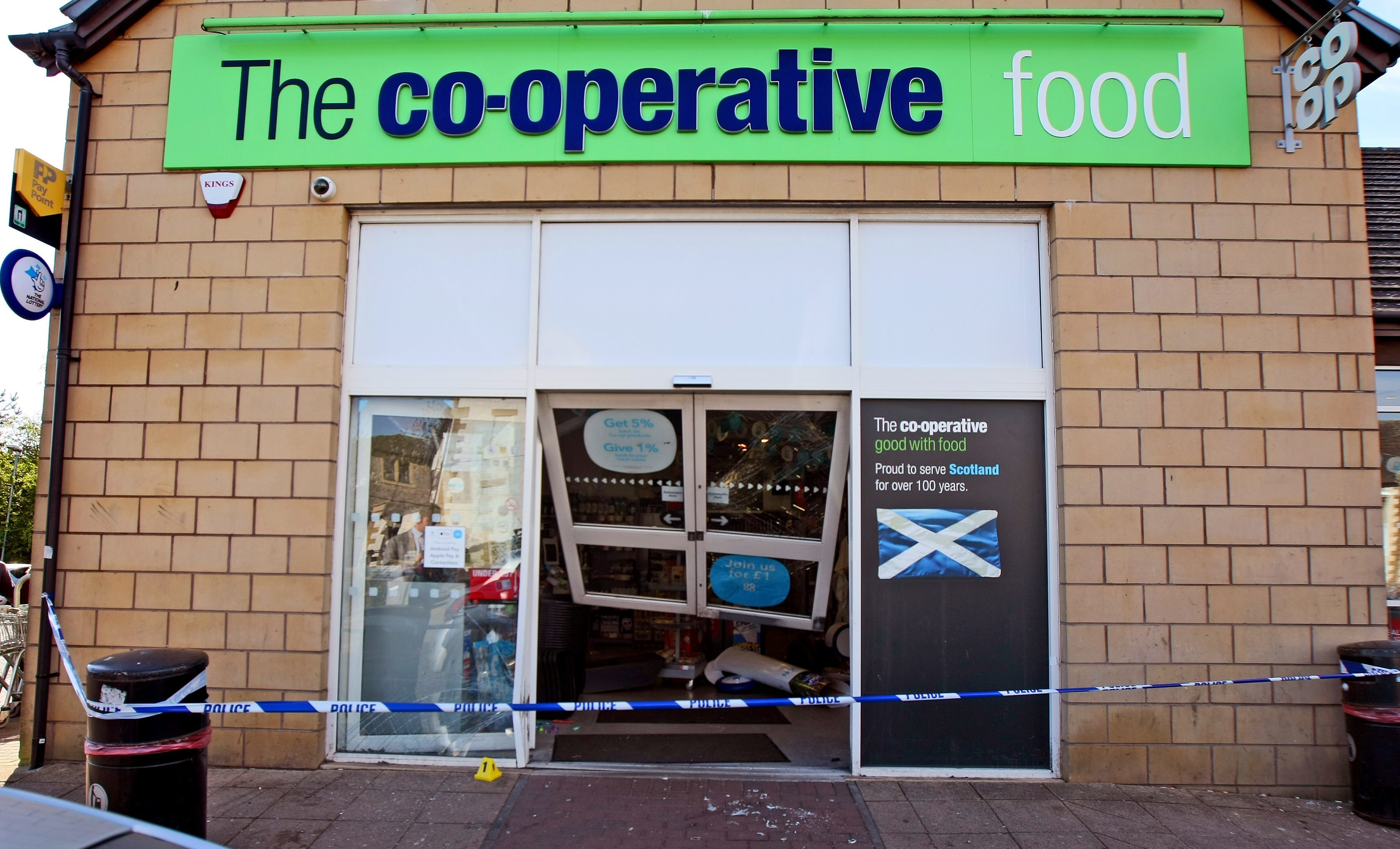 Raiders used a BMW to force the shop's door open.