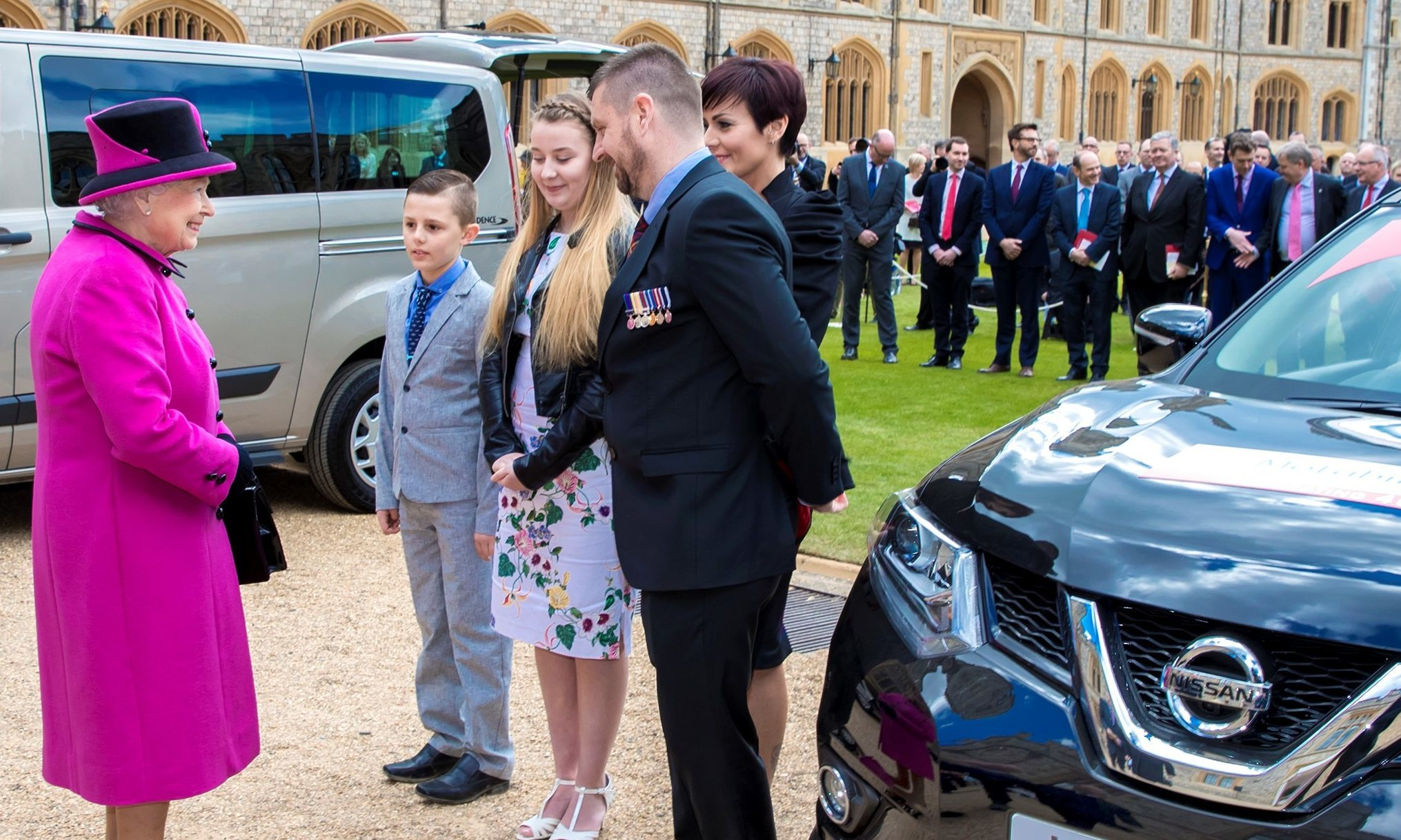 The Queen meets Paul and his family to present the keys to the new Motability vehicle.