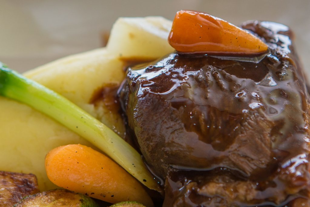 Slow Brazed Ox Cheek with Mashed Potato, Spring Veg and Red Wine Sauce