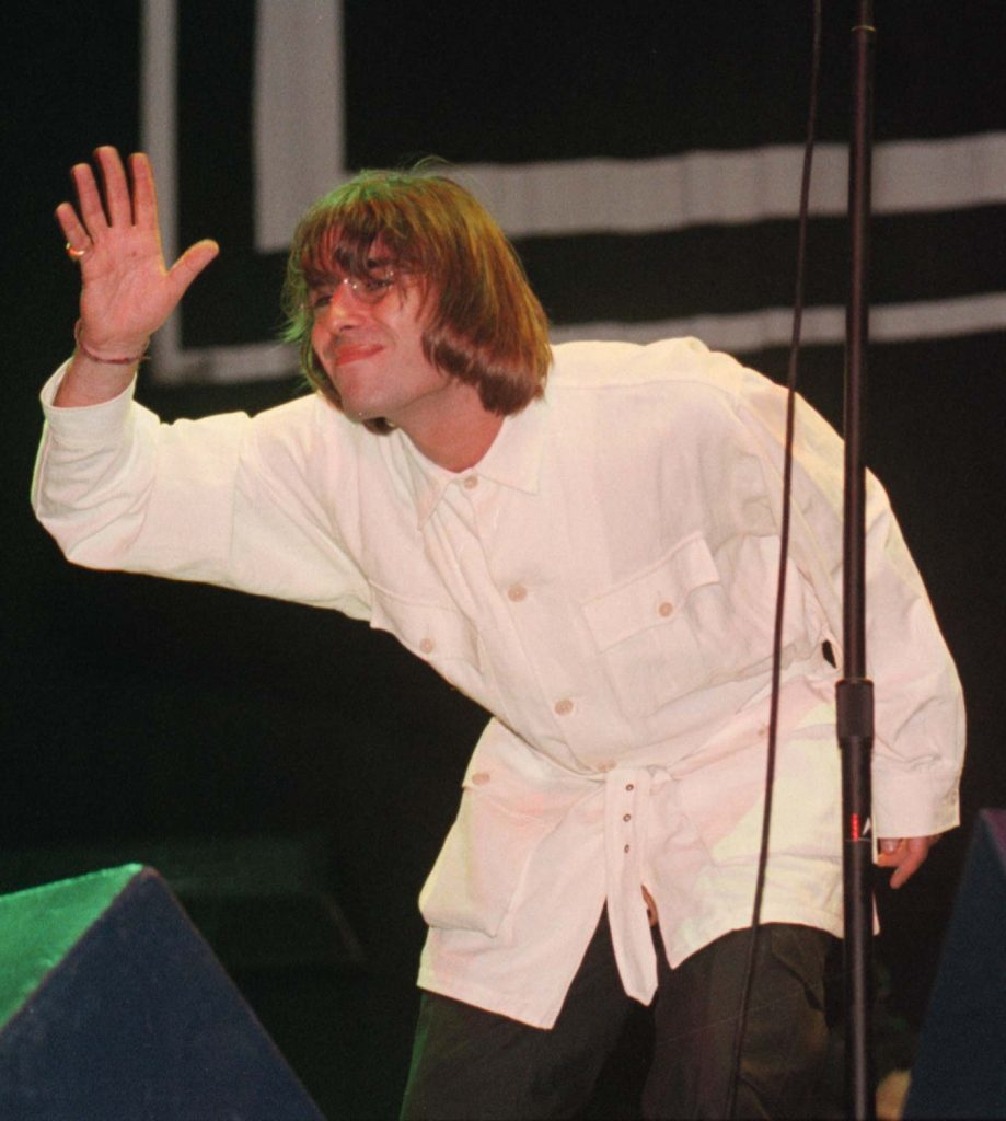 Liam Gallagher waves at the audience during the Oasis concert at Knebworth in Hertfordshire.
